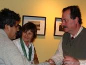 En Puerto Tirol, con Graciela Barrios Camponovo, L. G. saluda un asistente a su conferencia sobre Quiroga, Puerto Tirol, 2008